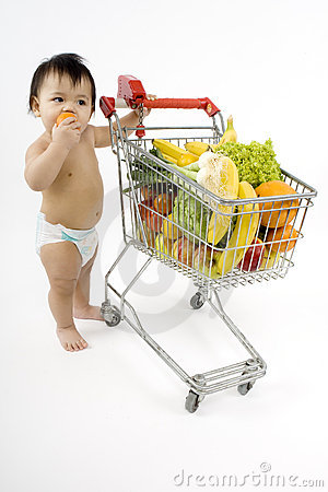 Free Baby Pushes A Shopping Cart Royalty Free Stock Photography - 5217197