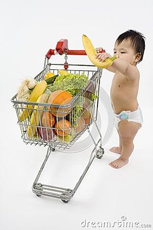 Free Baby Pushes A Shopping Cart Royalty Free Stock Photos - 5217248