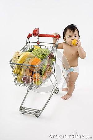 Free Baby Pushes A Shopping Cart Royalty Free Stock Photos - 5217268