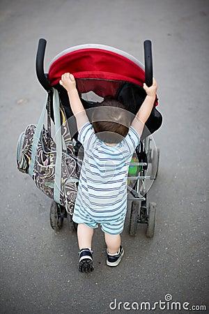 Baby pushing stroller