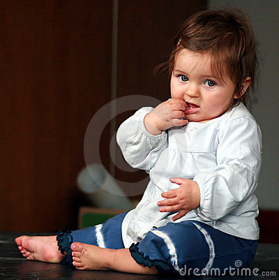 Baby putting something in mouth