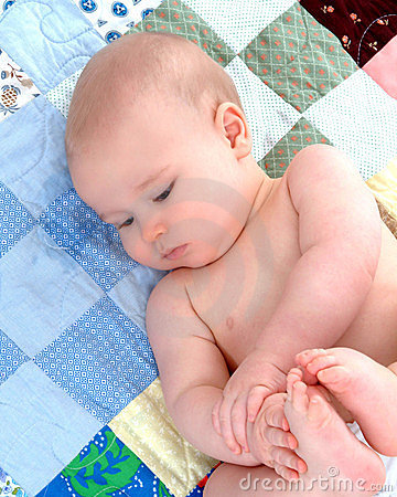 Baby on Quilt - Contentment