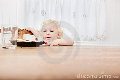 Baby reaching for food