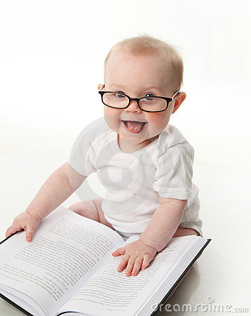 Baby reading with glasses