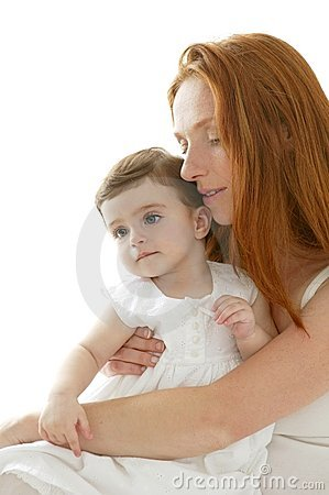Baby and redhead mother hug on white