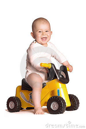 Baby rides a motorbike