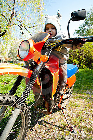 Baby Riding Motorcycle Royalty Free Stock Photography - Image: 20138157