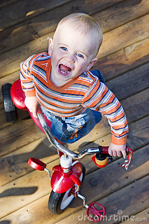 Baby riding tricycle