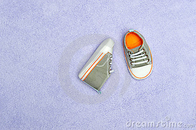 Baby shoes on blanket