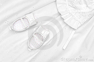 Baby shoes on dress