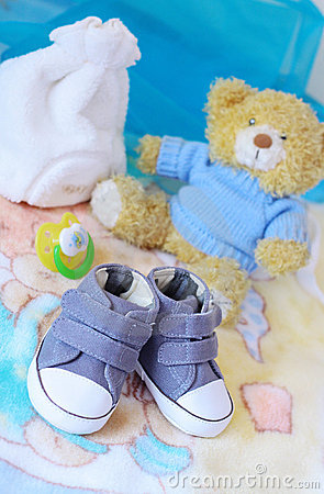 Baby shoes and teddy bear in blue