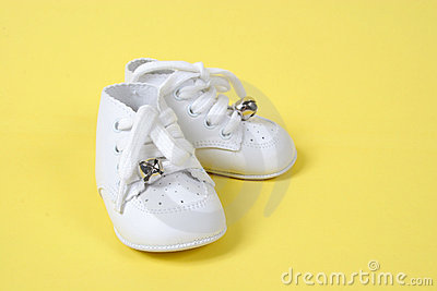 Baby Shoes Together on Yellow