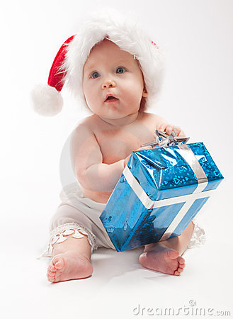 Baby sits with blue present box
