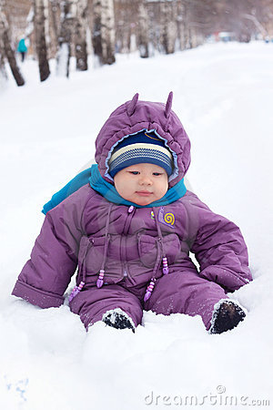 Baby  sits in the snow