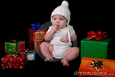 Baby Sitting Amongst Christmas Gifts