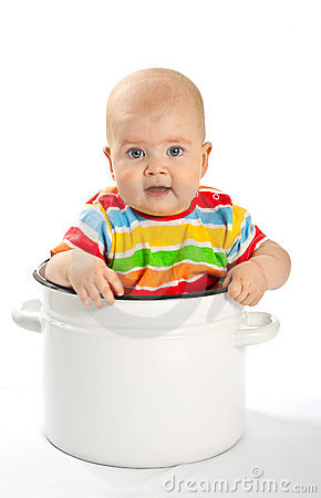Baby sitting in the big saucepan.
