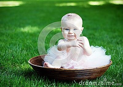 Baby Sitting in Bowl Smiling - horizontal