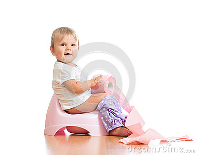 Baby sitting on chamber pot with toilet paper
