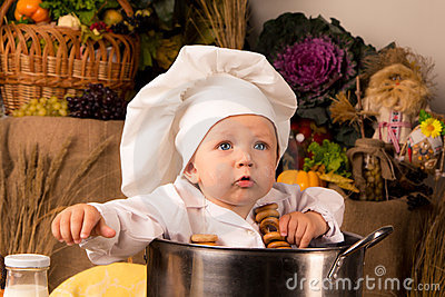 Baby sitting inside a large cooking stock pot
