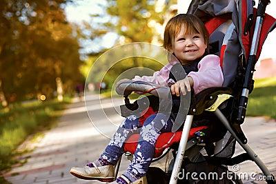 Baby in sitting stroller