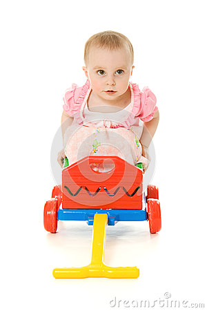 Baby sitting on a trolley