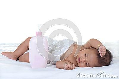 Baby sleep on a bed