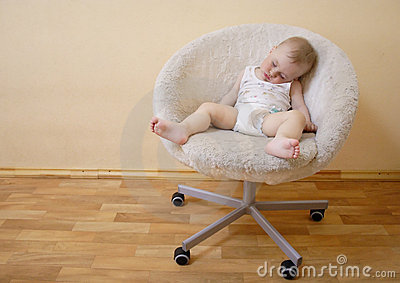 Baby sleeping on chair