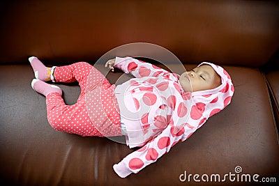 Baby sleeping on a sofa