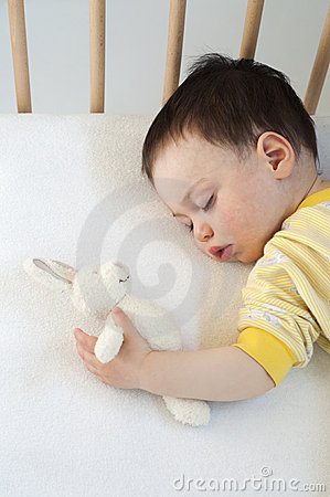 Baby sleeping with a soft toy