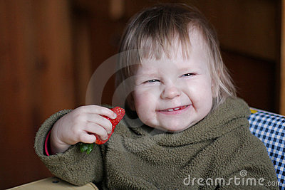 Baby with strawberry