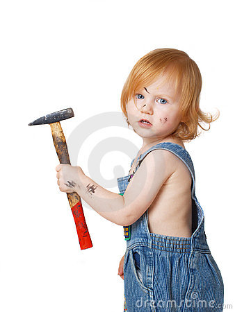 Baby with tool isolated on white