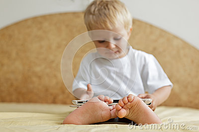 Baby with touch pad at home