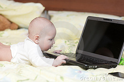 Baby touching laptop