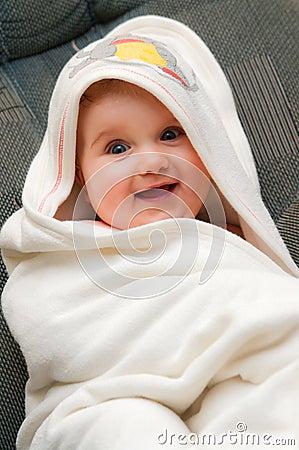Baby in towel after bath