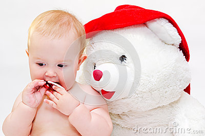 Baby with a toy bear