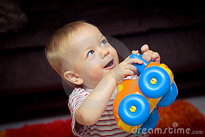 Baby with toy car