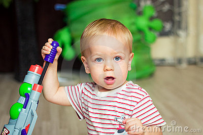 Baby with toy gun