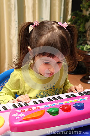 Baby and toy piano