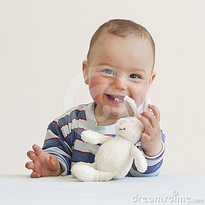 Baby with a toy rabbit