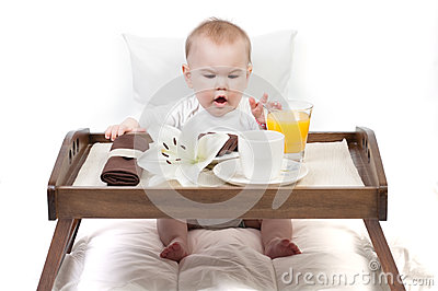 Baby and a tray with breakfast
