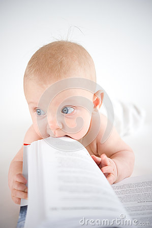 Baby trying to eat a book