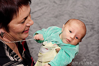 Baby trying to steal grandmothers necklace