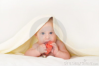 Baby under towel with toy