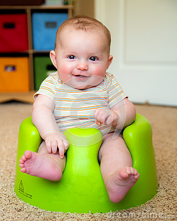 Baby using training Bumbo seat to sit up