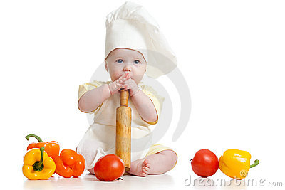 Baby wearing a chef hat with healthy  food