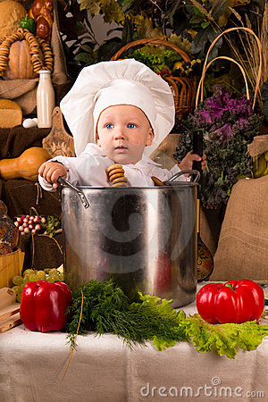 Baby wearing a chef hat inside a cooking stock pot