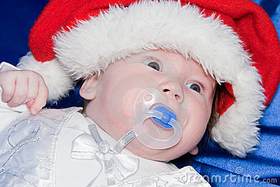 Baby wearing a red and white Christmas Santa hat