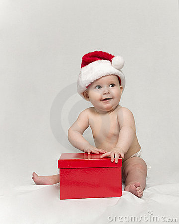 Baby wearing santa Hat with Red Christmas Present