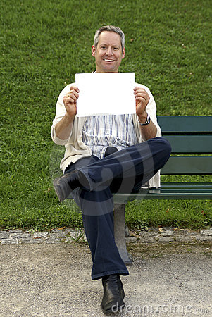 Babyboomer sitting and holding a blank sign