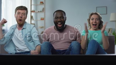 Bachelor and neighbor couple watching football championship on tv screen home. Stock footage stock video footage